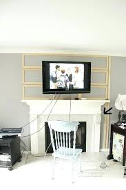hiding tv above fireplace how to hide wires above fireplace pics over fireplace x hiding
