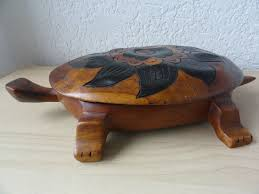 unique wooden sculpture of a turtle from haiti