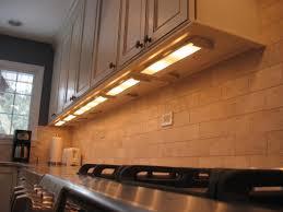 over stove lighting. Subway Backsplash Ceramic Tile Wall Kitchen Design With Under Cabinet Lighting Over Modern Stove S