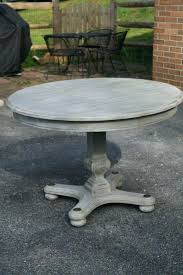 weathered round dining table oak and chairs