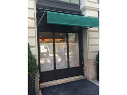 le bilboquet restaurant thermally broken stainless steel entry doors vestibule glazing brass pull handles