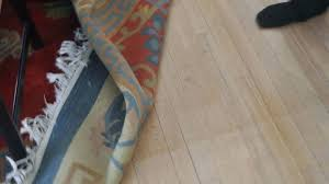 keep rugs from slipping how to stop stains on wood floors caused by and carpets sliding how to keep rugs
