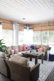 the tobago outdoor collection on a screened in porch decorated for entertaining and relaxing