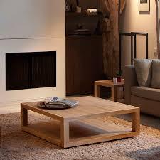 simple extra large low wooden square coffee table on cream fur rug for living room with