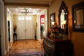foyer furniture ideas. Incredible Gorgeous Small Foyer Ideas Rior Design With Brown Drawer Feat Planters And Table Lamps Close To Mirror Photo Frames For Entryway Furniture