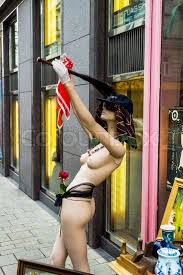 A Naked Mannequin In Front Of A