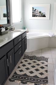 cheap bathroom makeover. Simple Makeover Sea Salt Walls Add Warmth Dark Grey Cabinets A Touch Of Modern To This Intended Cheap Bathroom Makeover