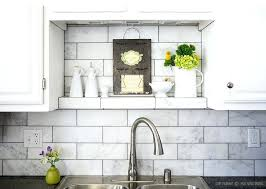 large subway white marble tile backsplash with grey grout idea