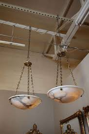 elegant pair of french alabaster pendant lights with bronze fittings in the directoire style interior