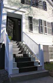 painted exterior stair runner and dark pain on foundation