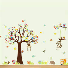 great looking tree flowers owl animal wall decals for nursery room with laminated wooden floor idea