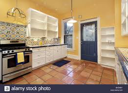 Terra Cotta Tile In Kitchen Kitchen In Suburban Home With Terra Cotta Floor Tile And Yellow