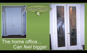 etched palm tree glass office doors