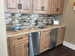 solid surface countertop with mixed tile backsplash