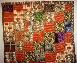 Quilting Links U.S. and Africa :: IRAAA & Georgia might work on the same quilt for a number of days and Improvisation  using contrasting colors repeated diagonally. Mohammed Omar - Accra, Ghana. Adamdwight.com