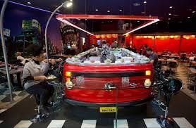 volkswagen van hippie interior. people dine at the nakombi restaurant in sao paulo brazil volkswagen van hippie interior