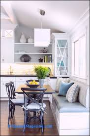 lovely eat in kitchen is filled with a built in dining bench and window seat facing