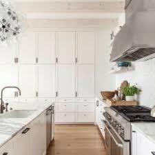 Image Custom Bright Transitional Kitchen With Floortoceiling White Cabinets Photos Hgtv Photos Hgtv