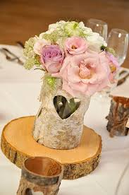 rustic centrepieces tree slices ngton moor wedding flowers passion for flowers