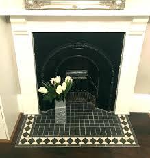 black tile fireplace flooring intricate floor tiles around mosaic ideas repair glass surround t tile around fireplace black