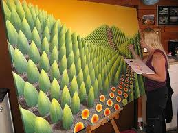 surreal painting working on a large canvas by patricia van lubeck