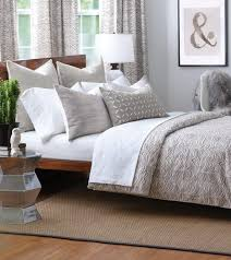 charming bedroom with cherry wood platform bed and silver bedside table plus grey bedding eastern accents
