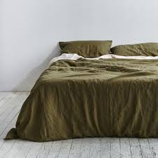 the 100 percent linen duvet set in moss from australian company in bed in collaboration