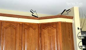 adding crown molding to kitchen cabinets adding height to your kitchen cabinets with simple molding adding adding crown molding to kitchen cabinets