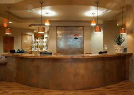 reception desk in antique copper curved steel top and wood face