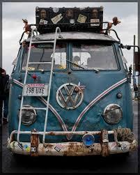 volkswagen van hippie blue. vw camper van bus - with luggage rack filled. volkswagen hippie blue