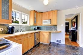 Birch Wood Sage Green Shaker Door Light Colored Kitchen Cabinets Backsplash  Mirror Tile Stainless Teel Recycled Countertops Sink Faucet Island Lighting  ...