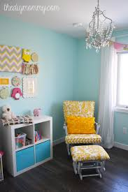 a sunny woodland nursery this sweet nursery is decorated in aqua yellow blush