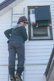 biologist kaleigh norquay installs a heated bat box on a house in sudbury chris blomme
