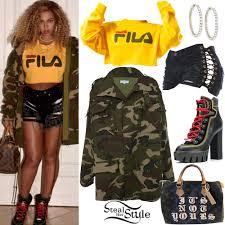 fila yellow hoodie. beyoncé: yellow fila top, camo jacket hoodie