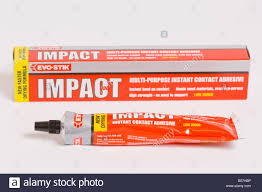 tube of evo stik impact multi purpose instant contact adhesive stock photo tube of evo stik impact multi purpose instant contact adhesive glue on white background