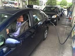 oregon department of transportation spokesman tom fuller fills his tank at a gas station in m oregon