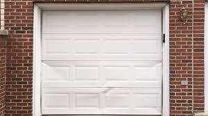 repair or replace dented garage door panel