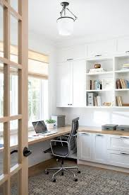 chic first floor home office features floor to ceiling white built in shelves cabinets chic home office features