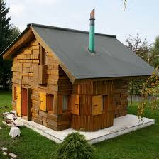 Watch out for splinters! Artist's barking mad (geddit!) book-shaped house  is carved and furnished entirely out of wood | Ideal Home