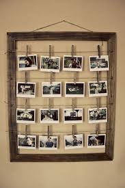 Loving this simple wooden frame for hanging photos. All it takes is some  string or
