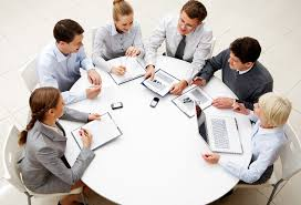 business meeting sitting at round table from above 6 ways to improve the ivity of your