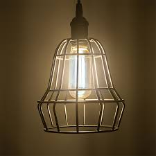 led vintage light bulb t14 shape radio style led bulb with filament led installed in decorative cage fixture