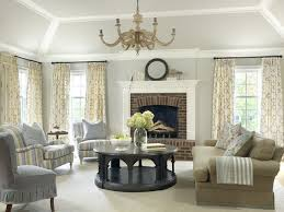 Example of a classic living room design in St Louis with gray walls