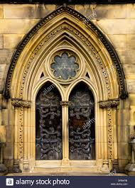 Medieval Doors detail of ornate wooden doors and arches all saints church in 6593 by xevi.us