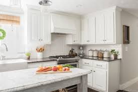 how to paint oak cabinets learn about our proven process for how to paint kitchen cabinets and how we hid the grain to achieve factory like results