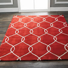 Red kitchen rug on gray wooden floor chair railing on the walls