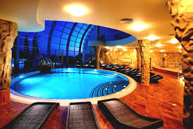 home indoor pool with bar. Extravagant Indoor Swimming Pool For Cozy Feels Eccohome With Rattan Lounge Together Wall Stones Home Bar O
