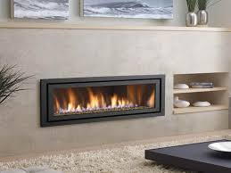modern ventless gas fireplace with white soft carpet