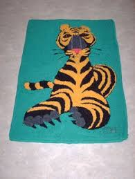 rug tufting tool. tiger design taken from rc colouring book. made with a rug crafters speed tufting tool e