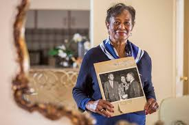 Ida Gaines holds a newspaper clipping from Martin Luther King's ...